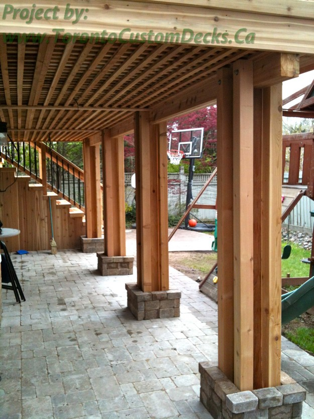 Gallery of 2nd level cedar deck with basement walkout in
