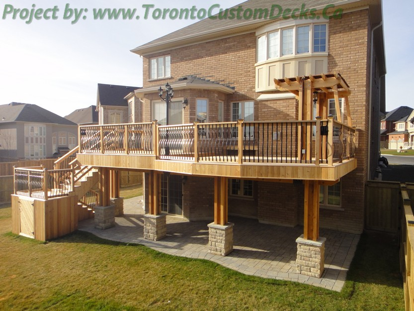 Backyard covered patios - Custom Deck With Basement Walkout Interlock Toronto Custom Deck