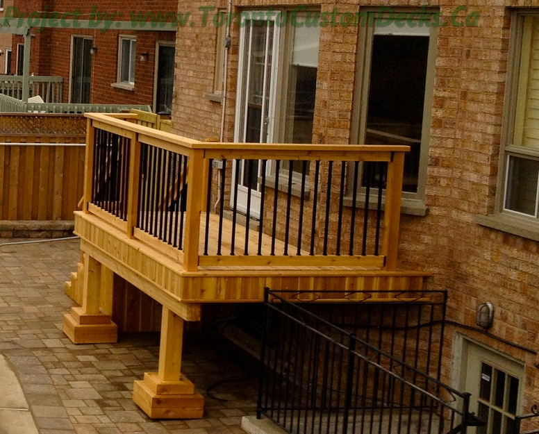 Gallery of a small cedar deck with wrought iron railings for Custom deck plans