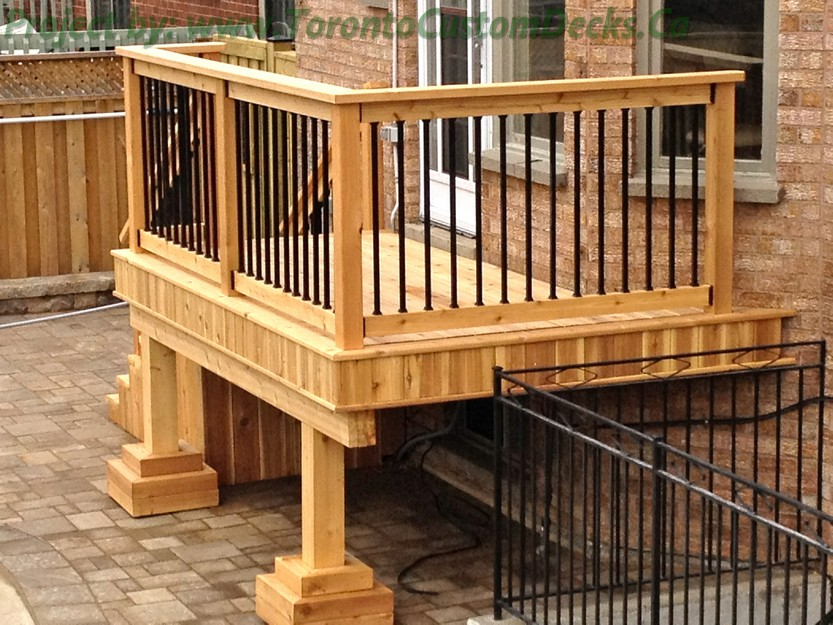 Gallery of a small cedar deck with wrought iron railings for Decorative railings