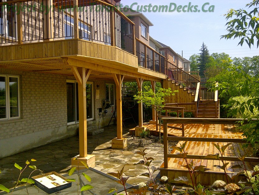 2nd level cedar deck with flagstone patio