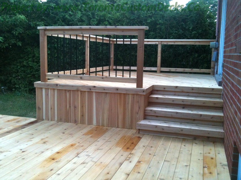 2 level cedar deck with wrought iron railings