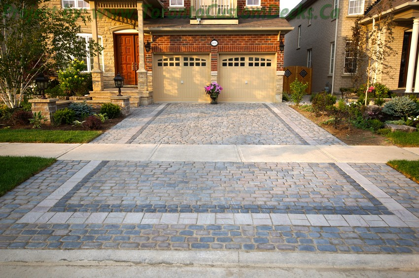 Front yard landscaping and interlock driveway