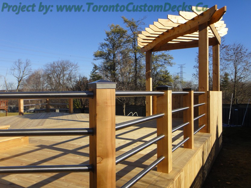 Walkout Patio deck with stainless steel railings and pergola