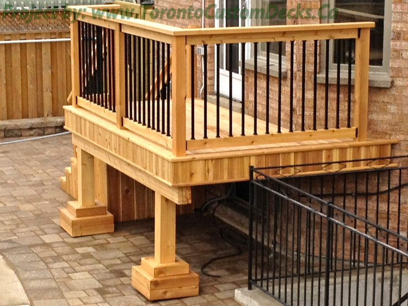 Small deck with wrought iron railings