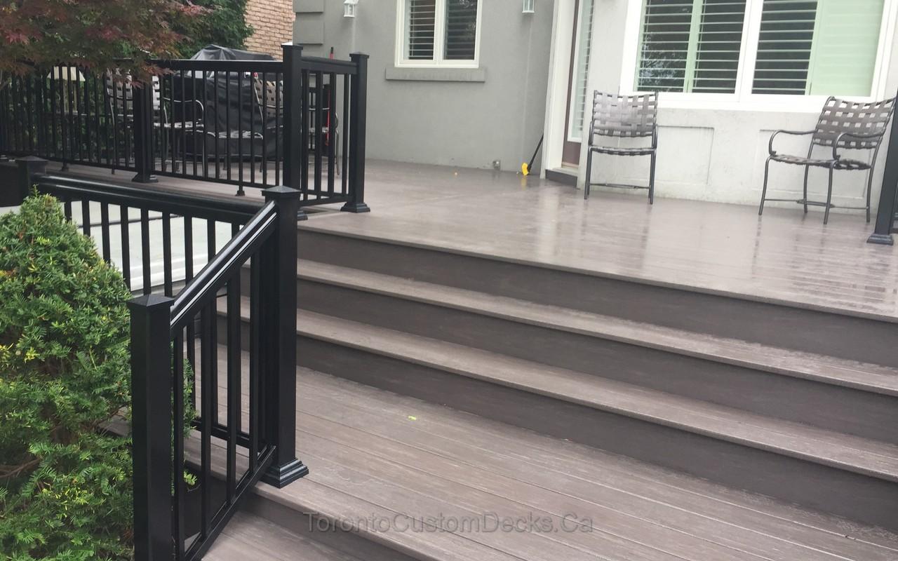 Composite deck with aluminum railings