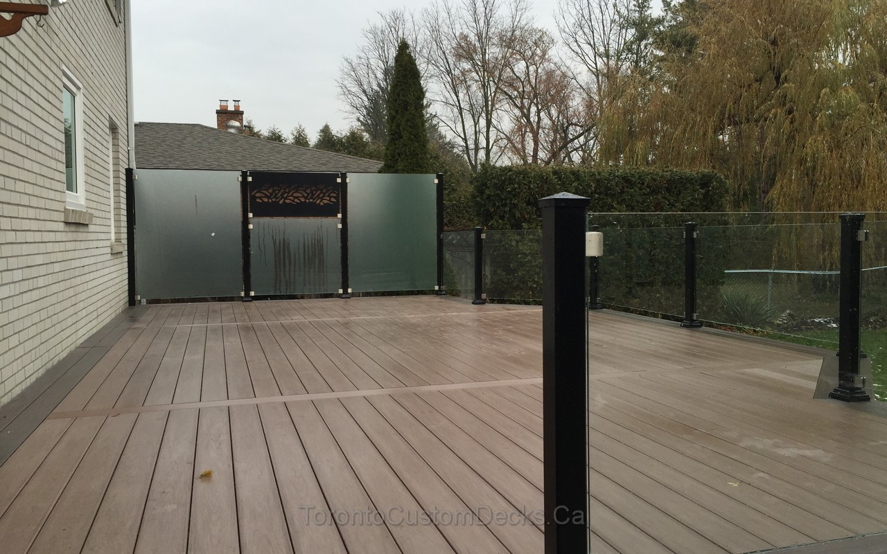 Composite deck with glass railings