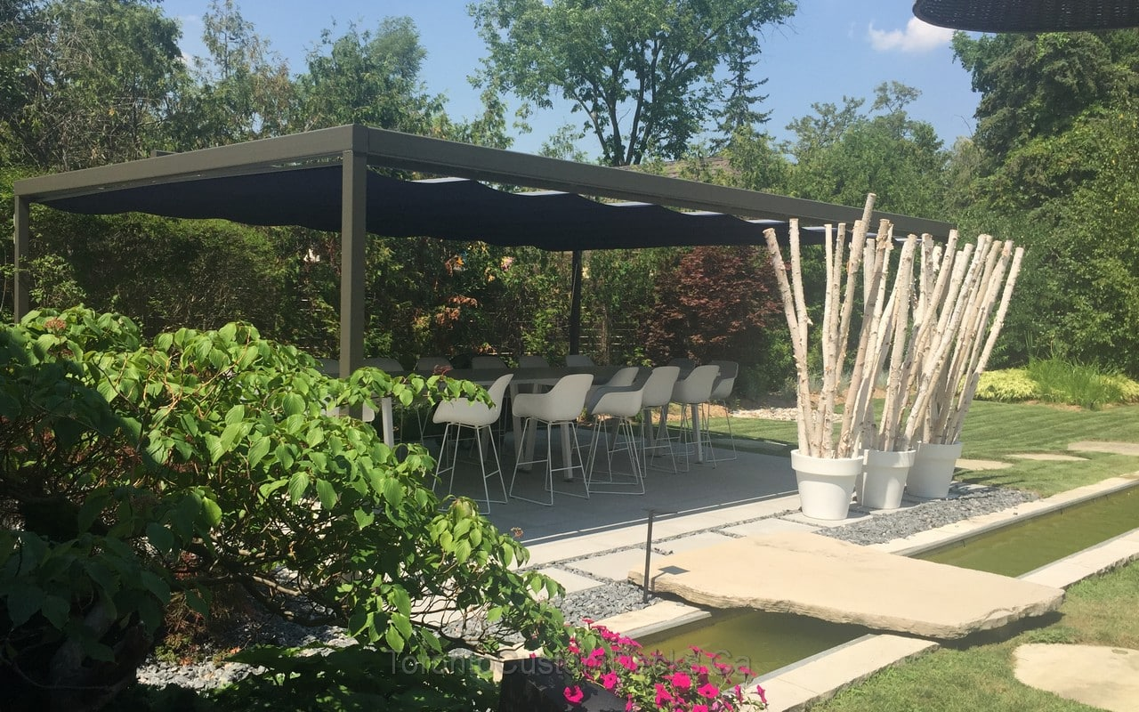Large pergola with interlocking and landscaping