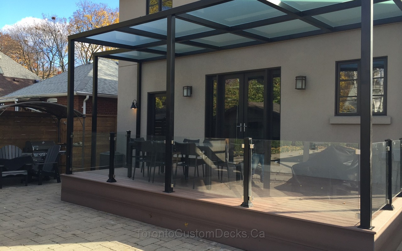 Landscaping project with PVC deck pergola and glass railings