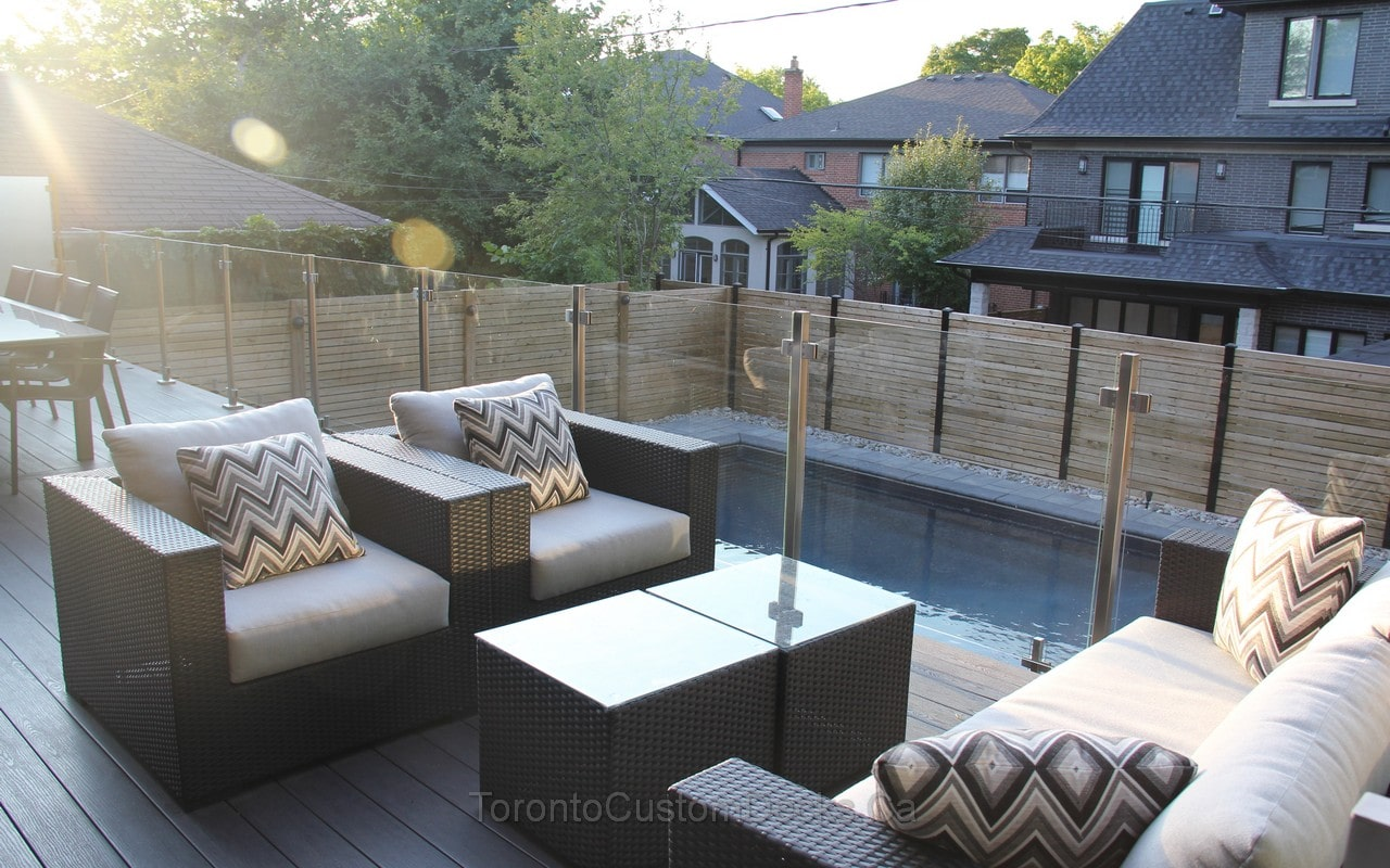 Composite deck with glass railings and fence